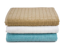 Colorful stacked bath towels isolated on white background Stock Images