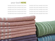 Colorful stacked bathroom towels isolated on white Royalty Free Stock Photos