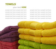 Colorful stacked bathroom towels isolated on white Stock Image