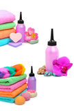 Colorful stacked spa towels. Bath bombs and shampoo bottle isolated on white Stock Photography