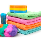 Colorful stacked spa towels, sea salt, mop and shampoo bottle is Royalty Free Stock Photo