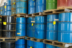 Colorful stacked steel barrels Royalty Free Stock Photo