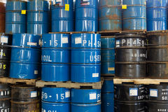 Colorful stacked steel barrels Stock Photo