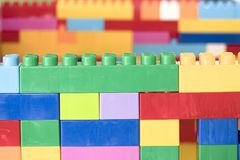 Toy plastic building blocks. Colorful stacked toy plastic building blocks Royalty Free Stock Images