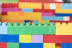 Colorful stacked toy plastic building blocks. And blur backgroundn royalty free stock photo