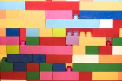 Stacked toy plastic building blocks. Colorful stacked toy plastic building blocks stock photography