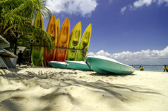 Colorful stacking kayaks on white sandy beach at sunny day. blue sky and clear sea water background. Image taken at Kapas Island (Cotton Island&#x29 Royalty Free Stock Photo