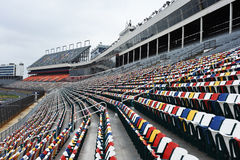 Colorful Stadium Seats. Colorful stadium and seats at a Nascar oval track stock image