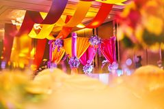 Colorful stage decoration for bride and groom in sangeet night o. Selective focus on the colorful stage decoration with bright shade of color for bride and groom royalty free stock images