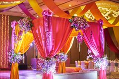 Colorful stage decoration for bride and groom in sangeet night of indian wedding. The colorful stage decoration with bright shade of color for bride and groom in stock image