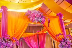 Colorful stage decoration for bride and groom in sangeet night of indian wedding. The colorful stage decoration with bright shade of color for bride and groom in royalty free stock images