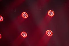 Colorful stage light background. Stage lights of different colors, background of glowing red spotlights royalty free stock image