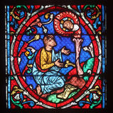 Colorful stained glass window in Cathedral Notre Dame de Paris Royalty Free Stock Image
