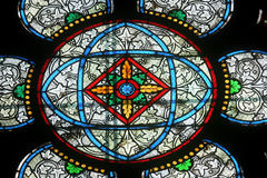 Colorful stained glass window in Cathedral Notre Dame de Paris Stock Image