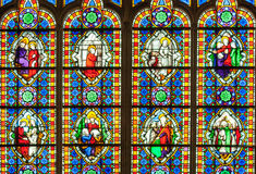 Colorful stained glass window with saints Stock Photo