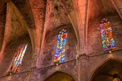 Colorful stained glass windows in the Cathedral of Santa Maria of Palma, also known as La Seu. Palma, Majorca, Spain royalty free stock photo