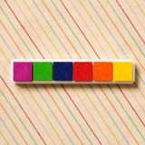 Colorful stamp ink on stripe pattern fabric background. Colorful stamp ink pad on stripe pattern fabric background royalty free stock photo