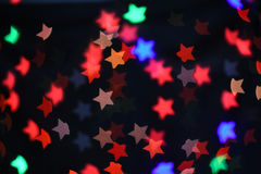 Colorful Star bokeh blurred abstract background. Christmas and new year party concept. Colorful Star bokeh blurred abstract background. Christmas and new year Royalty Free Stock Images