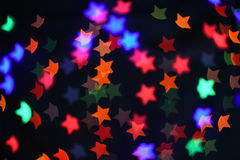 Colorful Star bokeh blurred abstract background. Christmas and new year party concept. Colorful Star bokeh blurred abstract background. Christmas and new year Royalty Free Stock Photo