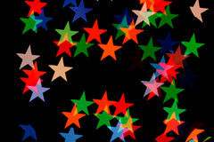 Colorful star shape boke on dark background Stock Images