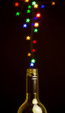 Colorful star shape lights floating out of the bottle Royalty Free Stock Photos