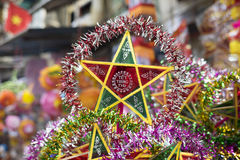 Colorful star shaped lantern for sale on an old street of Hanoi Royalty Free Stock Photos
