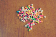 Colorful star-shaped sprinkles Royalty Free Stock Photos