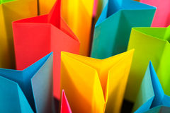 Colorful Star Shapes Abstract. Colorful paper in star/triangle shapes with shadows on a black background stock photo