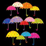 Colorful Umbrella on Black Background Royalty Free Stock Photography