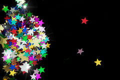 Colorful stars on black background Stock Image