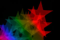 Colorful stars blurry lights. Colorful stars on black background abstract blurry lights Stock Photography