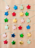 Colorful stars on brown paper Stock Photography