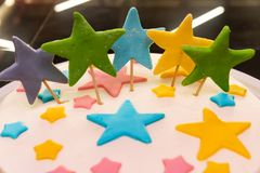Colorful stars decorate the cake, close-up stock photos