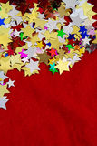 Colorful stars on red velvet background Royalty Free Stock Photography