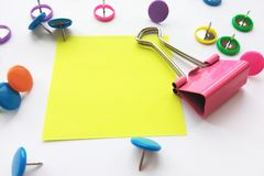 Colorful stationary, back to school, office, business and education concept. School and office supplies paper clips, pins on white royalty free stock photos