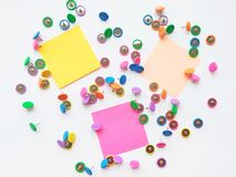 Colorful stationary, back to school, office, business and education concept. School and office supplies paper clips, pins on white. Background. Top view, close royalty free stock photo