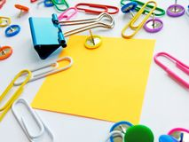 School and office supplies paper clips, pins, notes, stickers on white background royalty free stock photo