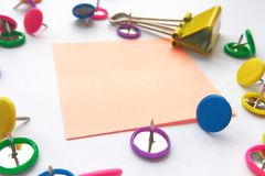 School and office supplies paper clips, pins, notes, stickers on white background. stock image