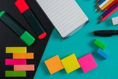 Colorful stationary mockup. Close up portrait of colorful stationary mockup on blue pastel background Stock Photo