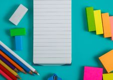 Colorful stationary set. Close up portrait of colorful stationary set with blank notes on blue pastel background Stock Photos