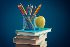 Colorful stationery and pile of books Stock Photography