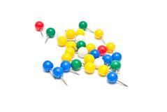 Colorful stationery pins on white Stock Images