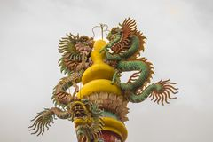Colorful statue of Chinese dragon wrapped around the pillar. Beautiful statue of dragon carved around temple pole in Chinese royalty free stock photos