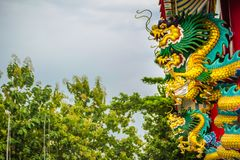 Colorful statue of Chinese dragon wrapped around the pillar. Beautiful statue of dragon carved around temple pole in Chinese stock image