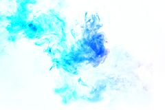 Colorful steam exhaled from the vape with a smooth transition of color molecules from turquoise to blue on a white background like stock image