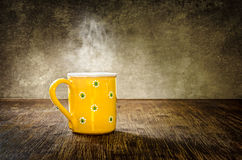 Colorful steaming coffee mug on the table Royalty Free Stock Image