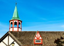 Colorful steeple and dormer window on thatched roof. Colorful Danish style steeple and dormer window on thatched roof in Solvang, California Stock Image