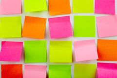 Colorful stickers. Image of colorful note papers stuck in several rows Royalty Free Stock Images