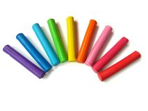 Colorful sticks plasticine, rainbow clay, beautiful curve dough, white background stock images