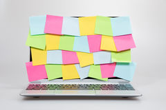Colorful sticky memos covering a laptop screen stock photo